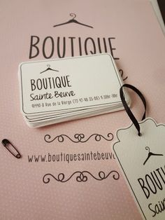 Logo, business card and tag for boutique. Hanger icon, pink & black color scheme. Cute, femenine & vintage. Designed by anasofía.