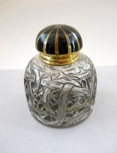 Lalique perfume bottle - 'Epines'.RENE' LALIQUE More Pins Like This At FOSTERGINGER @ Pinterest