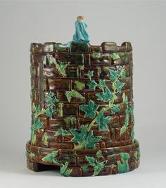 George Jones Majolica Cheese Dom with Fern and Ivy. Unusual deep brown ground.