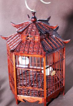Centerpiece - Bronzed/Golden Cricket Cage for the Mulan table Chinese Pagoda, Chinese Bamboo, Style Asiatique, The Caged Bird Sings, Asian Interior, Chinese Furniture, Bird Cages, Inspired Homes, Bird Feathers