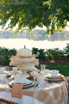 Lakeside fall table with white pumpkins and Mikasa Parchment Engraved dinnerware | homeiswheretheboatis.net…