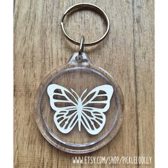 A personal favourite from my Etsy shop https://www.etsy.com/uk/listing/273896952/papercut-butterfly-keyring