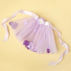 Make half of a tutu and sew ribbon to tie and you have an easy on easy off dress up essential.