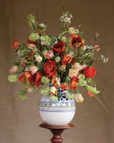 To get this look, fill a vase with tulips, viburnum, apple blossoms, hosta leaves, and hellebores.
