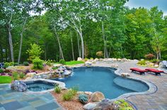 -Oversized, and raised, custom spa -Large natural boulder waterfall with dedicate pump -Pebble Tec Midnight Blue Pebble Tec -Tower Hill Granite coping -Extra-large top step / sun-shelf -Paramount PV-R in-floor cleaning system (pool is 99% vacuum free without the need of any type robot)