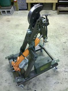 Tube Bender by 76scoutman -- Homemade tube bender utilizing commercial bender arms and dies. Powered by a hydraulic cylinder. Casters also serve as levelers. http://www.homemadetools.net/homemade-tube-bender-19