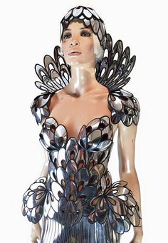 Chrome conchas art nouveau inspired corset , burlesque performer futuristic gear