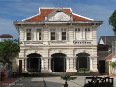 """The Thai Hua Museum is dedicated to recounting the history of the Chinese people in Phuket, from the first big wave of immigrants who came to the island in the nineteenth century to work the tin mines through to the merchants and others who built Phuket into a powerful trading center. The museum was opened in 2010 using the old Thai Hua school, the oldest Chinese-language school in Phuket. The building is a classic """"Sino-Portuguese"""" styled building, blending European styles with Chinese…"""