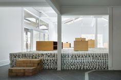 Yusuke Seki stacks concrete-cast ceramics inside the Maruhiro flagship via Frameweb.com