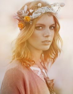 bohemian hair. recycled newspaper and wildflowers.