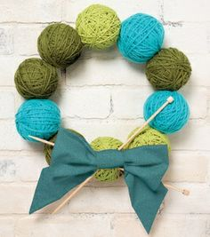 Love this Yarn Ball Wreath!! Could keep it up all year long in my craft room!!.