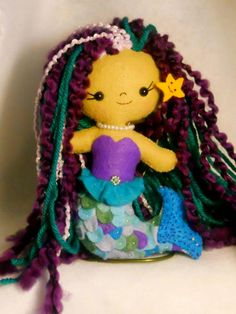 "Mirabella is a pretty li'l mermaid. She stands about 5 1/2"" tall and is completely handsewn and made from wool blend felt. She is $35+5.00 postage via PayPal.  https://www.etsy.com/listing/113951639/ooak-happy-lil-felt-mermaid-doll"