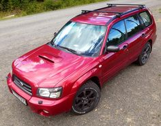 Subaru Forester 2.0XT. Not my favourite colour but with these wheels it looks awesome.