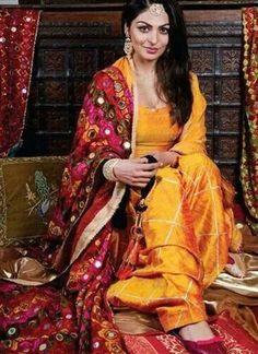 Neeru Bajwa Mango Yellow color Raw Silk Punjabi Salwar Kameez With Phulkari Dupatta at Zikimo 1