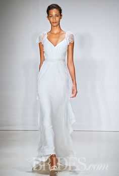 A Kate Middleton-esque gown with flutter sleeves by @christosbridal | Brides.com