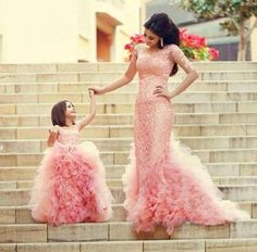 Beautiful long pink mermaid dresses for mother and daughter.