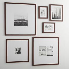 Classic brown wood and extra-wide white mat frames in a modern, gallery-style presentation.