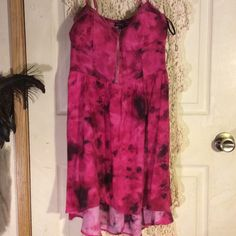 Gorgeous gorgeous hi low dress..PRICE IS FIRM! In excellent condition! Beautiful hot pink and black floral design, I so wish I could still fit this beauty. PRICE IS FIRM,! Material Girl Dresses High Low