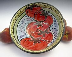 Check out this item in my Etsy shop https://www.etsy.com/listing/47990005/ceramic-pottery-red-tomato-bowl-majolica