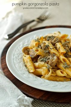 Pasta and mushrooms in a creamy pumpkin gorgonzola cheese sauce