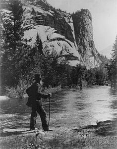 John Muir standing beside the Merced River, Yosemite