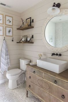 Two favorites in this bathroom- an old dresser turned into a vanity, and…