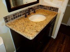 Backsplash matched accent tile in tub