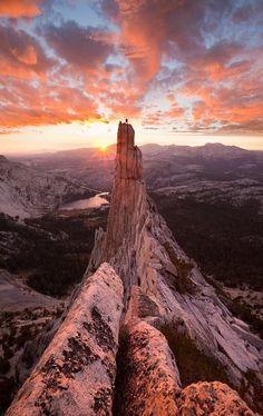a climber stands atop eichorn pinnacle in yosemite national park, california. photo Grant Ordelheide Photography