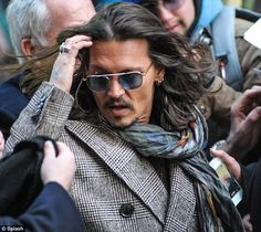 Wild Mane: Johnny made quite an entrance outside the studio for The Late Show with David Letterman