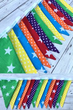 Bright and colourful fabric bunting with a combination of spots and stars in red, yellow, orange, green, blue and purple finished with white bias tape. Great for parties, playhouses and childrens rooms Fabric Wall Decor, Fabric Bunting, Room Pictures, Pictures To Draw, Rainbow Bunting, Simple Pictures, Room Carpet, Room Planning, Room Wallpaper