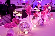 White vases, floating candles, bright floral, and disco balls. #studioag