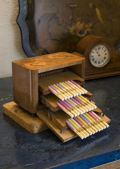 Wooden cigarette box with coloured cigarettes in the Dining Room at Coleton Fishacre, the house designed in 1925 for Rupert and Lady Dorothy D'Oyly Carte at Kingswear, Devon (National Trust)