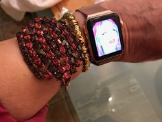 Apple Watch with arm candy--vintage brooch attached to vintage rose gold watch strap, vintage Trifari bracelet....