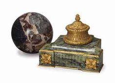 A GILT METAL AND VARIGATED GREEN MARBLE INKWELL, AND A VARIGATED RED AND BLACK MARBLE SPHERE,