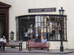 Residents sit outside the tourist office in the centre of Jamestown, the capital of the South Atlantic island of Saint Helena