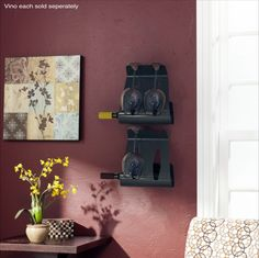 Vino | Mounted to a wall two Vino wine bottle holders, each painted in gunmetal grey, are akin to sculptures of solid steel. Holds one standard-sized wine bottle and two wine glasses each. (Each sold separately.) Contemporary Wine Racks, Bottle Wall, Wine Refrigerator, Wine Bottle Holders, All Modern, Floating Shelves, Tea Lights, Modern Design, Kitchen Products
