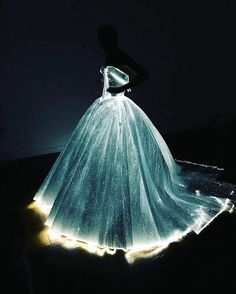"""On fashion's biggest night, Claire Danes' voluminous LED-lit dress by Zac Posen stole the spotlight. The NYC-based designer described his custom dove gray """"Galactic Cinderella"""" creation that Homeland's leading lady wore to the Met Ball as """"technology meets fantasy."""" It's not surprising that Posen, who"""