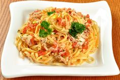 Linguine with Crab ~ A simple, elegant pasta dish ~ linguine w/a light sauce of lump crabmeat, fresh tomatoes, butter & white wine ~ from www.mygourmetconnection.com/recipes/main-courses/pasta-pizza/