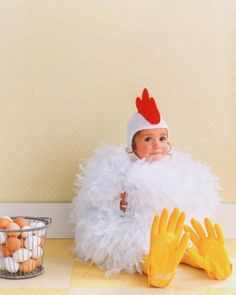 This baby chicken costume is made from two tickly feather boas, ordinary kitchen gloves, yellow tights, and a pilot& cap that& crowned with a felt comb. Baby Chicken Costume, Baby Skunk Costume, Baby Owl Costumes, Cute Baby Halloween Costumes, Chicken Costumes, Toddler Costumes, Diy Costumes, Halloween Kids, Costume Ideas