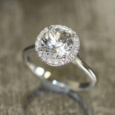 This halo engagement ring is designed for those who love simple yet elegant crystal clear gemstone ring with stunning diamond accent! The center