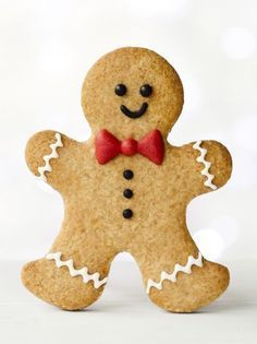 Gingerbread man by RuthBlack. Gingerbread man with red bow tie Christmas Cupcakes, Christmas Desserts, Christmas Treats, Christmas Recipes, Christmas Biscuits, Gingerbread Man Cookies, Christmas Mood, Retro Christmas, Christmas Cooking
