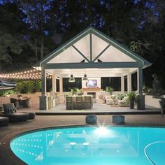 Outdoor kitchen pool house at night with bistro lights. Outdoor kitchen pool house at night with bistro lights. Outdoor Kitchen Design, Dream Backyard, Large Backyard, Patio Design, Outdoor Fireplace, Pool Houses, Pool House Designs