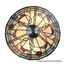 Design-TIFFANY-Deckenlampe CALLA FLEURS. ca.25cm hoch.ø40cm. 2xE-27, je 60W. Design= GJV-Glaskunst-Studio.  Ein eleganter TIFFANY-Lampenschirm mit leuchtenden den Blüten-Motiven in exellenter Verarbeitung.  Die eleganten Stiele der Blumen ragen aus dem Motiv hervor. Mit roten, purpur/lila und orangefarbigen Blüten.  Wird mit Deckenaufhänge-Scheibe geliefert, ist direkt an der Decke zu montieren.