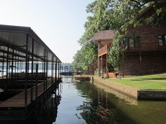 The side view of our house and boat dock at this luxurious, secluded Hot Springs, Arkansas lake house on Lake Hamilton. With 4 bedrooms and 3.5 bathroom's and the lake located just off the back porch, it is the perfect place for a family or corporate stay. It is available for renting all year round with a minimum of a 2 night stay. Check out Hot Springs horse racing at Oaklawn Race Track from January-April every year. Check it out at www.vrbo.com/425587 for booking.