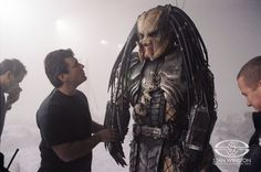 Alec Gillis gives last looks to one of the ADI-created predators on the set of AVP: ALIEN VS. PREDATOR.