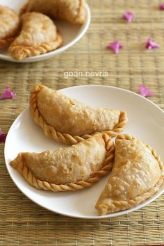 goan nevris recipe - deep fried pastries made with whole wheat flour and stuffed with grated coconut, jaggery and dry fruits #snacks #goan