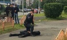 A Russian policeman stands over the suspected attacker in Surgut Siberia in a still image from a video shot by a witness. Photograph: YouTube  Eight people have been injured in a knife attack in the Siberian city of Surgut according to Russian news agency reports.  A man was running along the main streets stabbing people Tass reported citing the spokesman for the local office of the Russian law enforcement committee. The suspect was shot dead by police.  The male attacker carried out attacks…