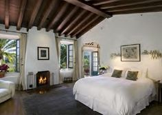 Lovely master bedroom. Love the fireplace and beamed ceilings.