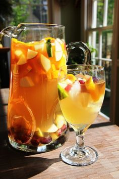 "The perfect cocktail for a big gathering is one that can be made ahead and is as bright and fresh as the weather. Exactly what inspired today's ""Cocktail Friday"" libation… White Sangria."