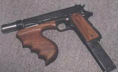 Dillinger's Colt M1911 machine gun pistol.  The Colt 1911 had seen many modifications over the past 100+ years, but one of the most interesting was by a quiet Texas gunsmith by the name of Hyman Lebman. His customers included the infamous gangsters John Dillinger and Baby Face Nelson, though this was unknown to him at the time, while his ingenious revisions to the classic handgun were equally dynamic.